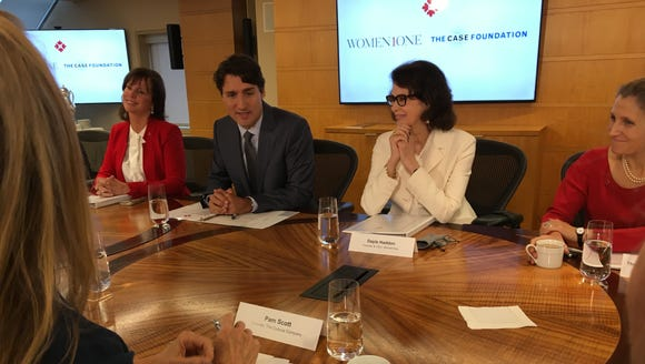 Canadian Prime Minister Justin Trudeau opens a roundtable