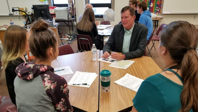 Brad Livingston gives mock interviews at North Middle School.