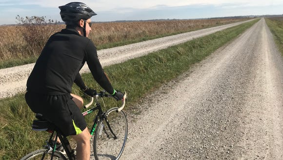 Bob Dohr rides on Dike Road, which cuts through the