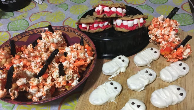 Popcorn pumpkins, Dracula's dentures and chocolate ghosties are easy and fun to make. They're sweet, spooky-looking and each one of these Halloween-themed desserts take less than an hour to make.