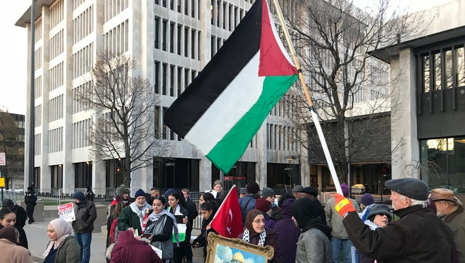 Local protesters gather outside Rochester's federal building Friday to voice dissent over President Trump's Jerusalem declaration earlier in the week.