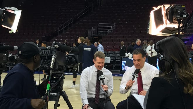 Fox Sports broadcasters Rob Stone (left) and Steve Lavin (right) conduct a pregame, live studio show on the Wells Fargo Center court prior to No. 10 Xavier's game against No. 1 Villanova on Jan. 10, 2018.