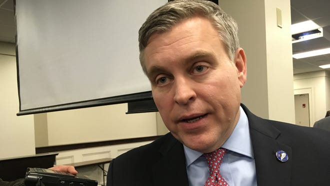 Kentucky Justice and Public Safety Cabinet Secretary John Tilley speaks with reporters on Tuesday, Jan. 30, 2018, in Frankfort, Ky. Tilley told lawmakers that without significant changes, Kentucky will run out of room for prisoners by May of 2019. (AP Photo/Adam Beam)