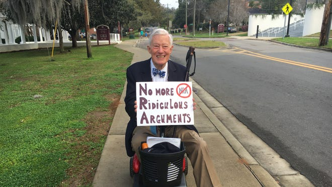 Former Florida State University President Sandy D'alemberte, cheered on Stoneman Douglas students as they marched up Pensacola Street to the Capitol, Feb. 21, 2018