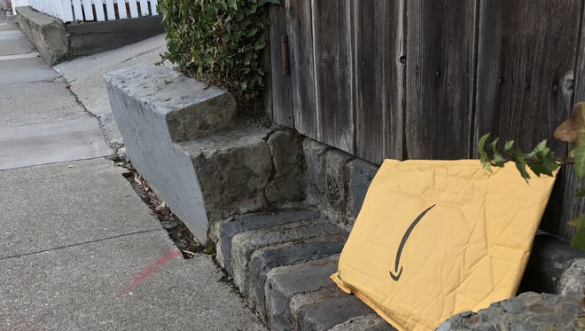 An Amazon package left outside a gate on a street in San Francisco.