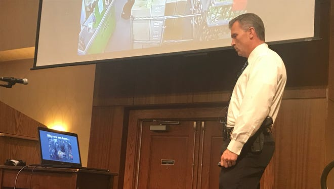 Abilene Police Chief Stan Standridge watches a surveillance video as part of the Civilian Response to Active Shooter Events training course he ran Thursday. Standridge used the video and several others to demonstrate why people need to make plans in case the unthinkable happens.
