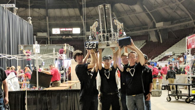 """Members of FRC Team 23 """"Lights Out"""" display their robot  """"Starstreak"""" at the Rock City Regional in Little Rock. Members of the team are: Chase Blum, Gage Simmons, Nick Huett, Xander Phillips and Ian Evans. John Taylor Novak, a student at MIT serves as coach and John Novak serves as a mentor."""