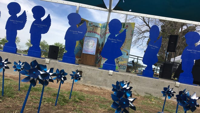 Blue Angels lined the stage at the 12th Annual National Crime Victims' Rights Week Expo at Young Park on April 7, 2018. The angels, with names on them, remember the children who have died in Doña Ana County due to child abuse or neglect.