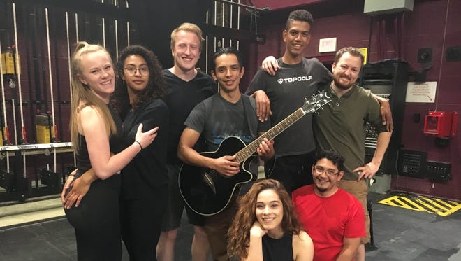 "The cast of ""Rent"" prepares for the April 27 opening. From left to right, Torrie Hughes, Ashiah Thomas-Mandlman, Calvin Chervinko, Juan Apodaca, Esmae Leon, Joseph Johnson, Maximilian Contreras and Ryan Thorpe."