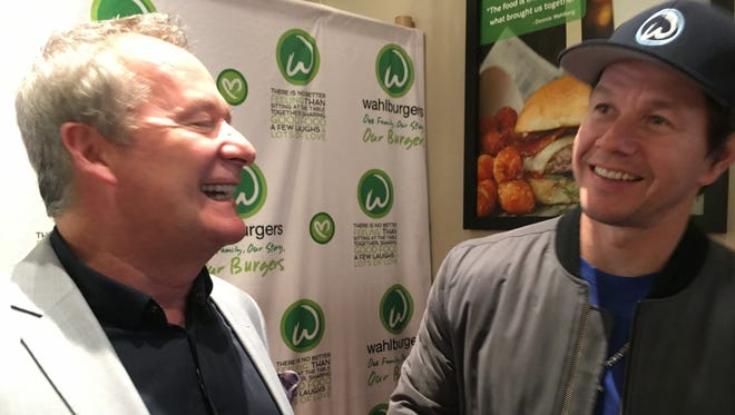 Nino Cutraro, Taylor Wahlburgers, franchise owner and actor Mark Wahlberg are pictured at the soon-to-open restaurant on Sunday, April 15, 2018.