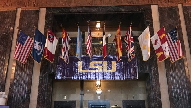 """An LSU banner hangs among the flags in the Capitol during the annual """"LSU Day at the Capitol."""""""