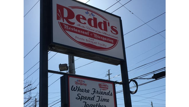 New sign reading Redd's Restaurant & Biergarten, replacing what was once called Redd's Restaurant & Bar.