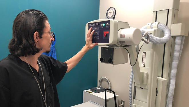David Whipple tests an X-ray machine at the USCareWays urgent care at Phoenix Sky Harbor International Airport on April 25, 2018.