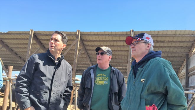 Gov. Scott Walker meets with Leon and Dennis Gohr inside their barn near Sobieski, Wisconsin on April 25, 2018, to see the damaged caused by the blizzard earlier this month. Several feet of heavy snow collapsed about half the roof of their barn, killing six animals immediately and forcing three others to shipped out.