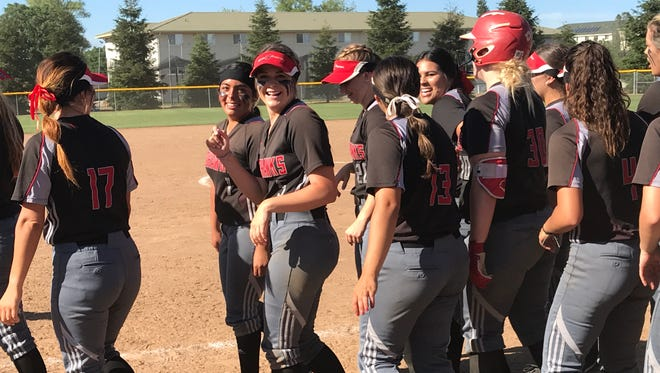 Simpson softball players celebrate Sunday afternoon after beating La Sierra 8-7 at home to win the Cal Pac Conference title.