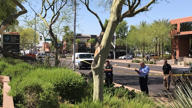 Police investigate a crime scene where a man stabbed near the intersection of Indian School and Scottsdale roads Tuesday morning