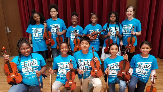 Fifth grade students from Lisa Foltz's string class at Sealey Elementary Math & Science Magnet School participated and played live with the Tallahassee Symphony Orchestra
