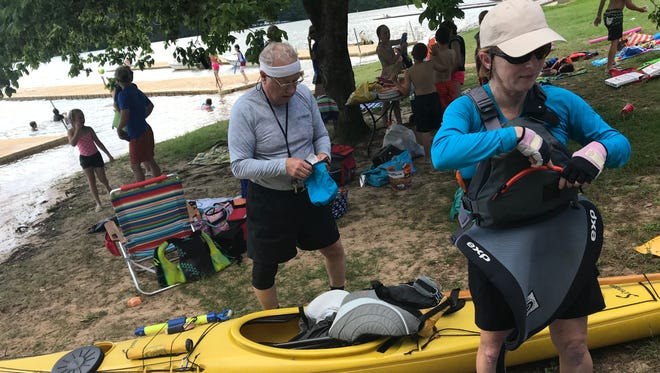 Karl Dieter and Janie Butcher gear up for a trip on their sea kayaks.