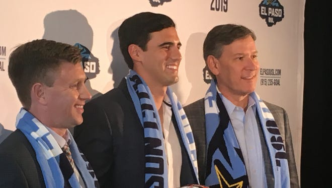 Former MLS No. 1 draft pick and Cathedral student Omar Salgado, center, poses with MountainStar Sports Group President Alan Ledford, right, and team general manager Andrew Forrest.