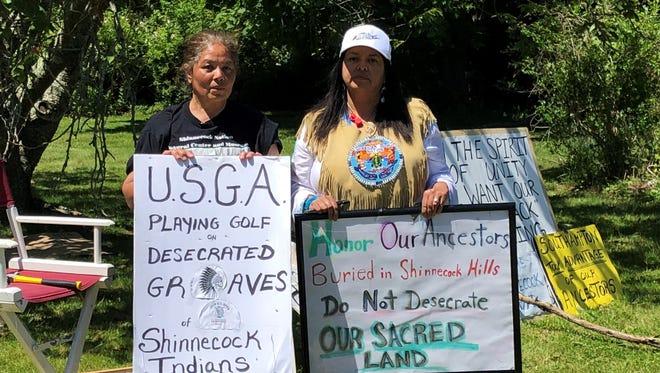 Rebecca Genia, left, and Denise Silva-Dennis were among the Shinnecock Native American protesters June 14 near the U.S. Open at Shinnecock Hills Golf Course.