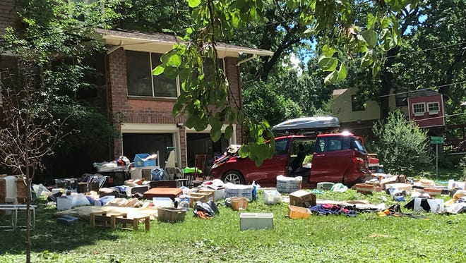 Damaged remnants of a creekside Beaverdale household hit by flooding