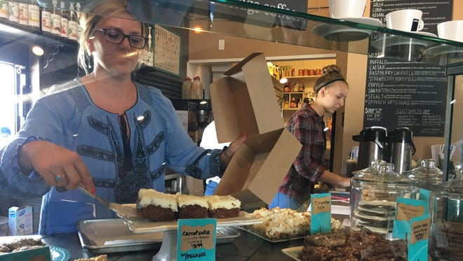 Bop's Bistro co-owner Jennifer Brzana packages bakery items in the De Pere cafe. Bop's, El Maya and other businesses at 1620 Lawrence Drive will close Aug. 31 after the property was sold.
