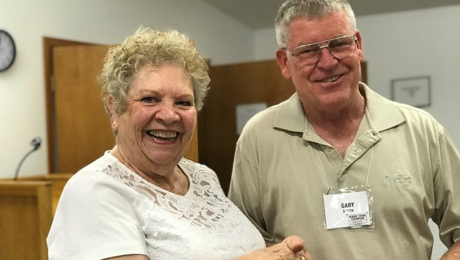 Lakeview Community Club Treasurer Gary Smith (right) presents a check for $1,500 to Judy Behling, chairwoman of the Celebrate Lakeview Festival.