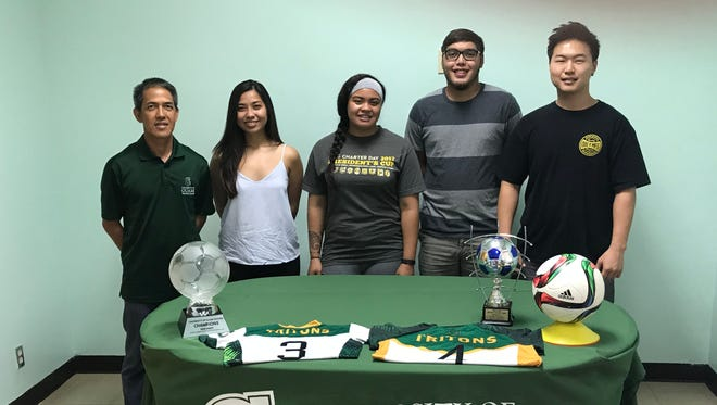 From left: University of Guam soccer coach Rod Hidalgo, Ariya Cruz, Koholali'i Jaertens, Joseph Quan, James Yang.