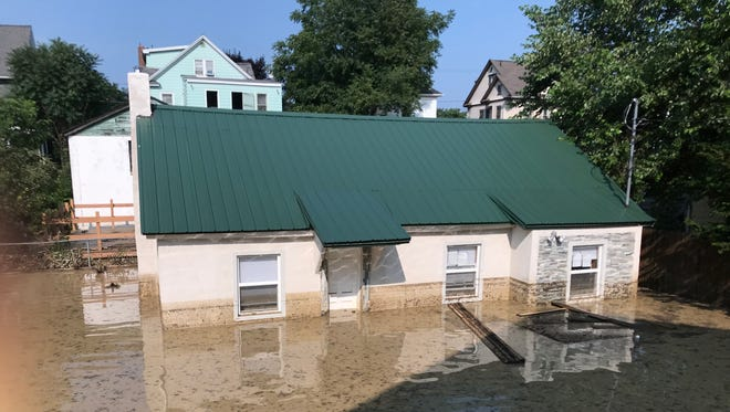 A two-bedroom home owned by Silakhone Saenglongma, located behind 19 Louisa Street in Binghamton, was submerged in water Wednesday morning.