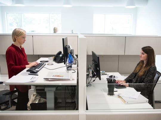 Katie Smith and Lauren Neely of the Hughes Agency work at their desks on Tuesday, Oct. 10, 2017.