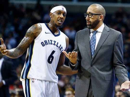 Memphis Grizzlies guard Mario Chalmers (left) chats