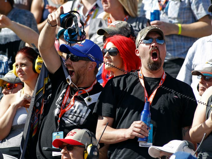 Race fans cheer on their drivers during the NASCAR