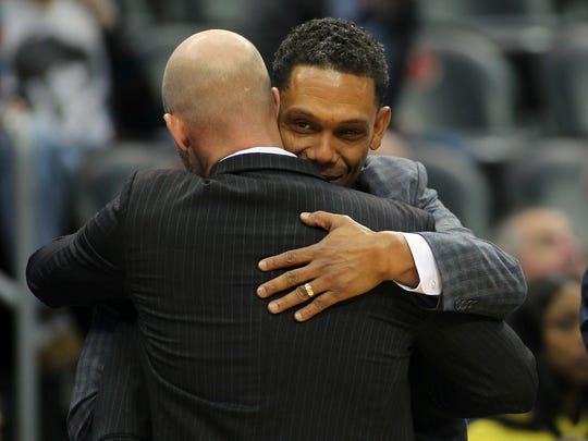 Seton Hall head coach Kevin Willard, left, embraces