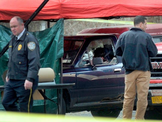 In this April 12, file photo, police work at the scene