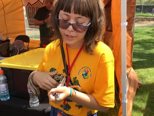 Kayla Rodriguez holds a hybrid snake, a combination