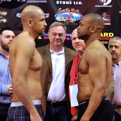 (l-r) Paul Vasquez and Roy Jones, Jr. during their