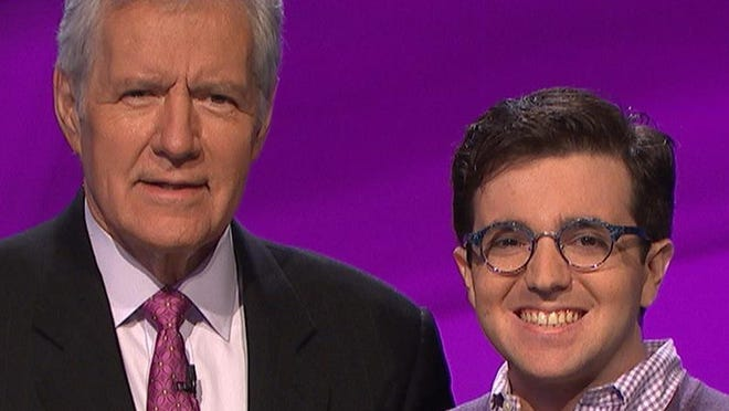 """Naples native Sacha Samotin, right, standing with Alex Trebeck on set of """"Jeopardy!"""""""