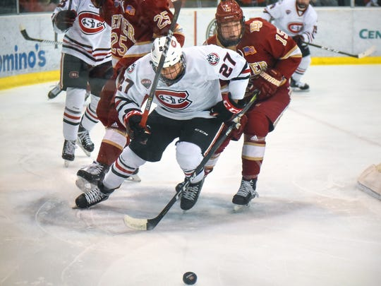 St. Cloud State's Blake Lizotte chases the puck behind the Denver goal during the first period of the Saturday, Feb. 24, game at the Herb Brooks National Hockey Center in St. Cloud.