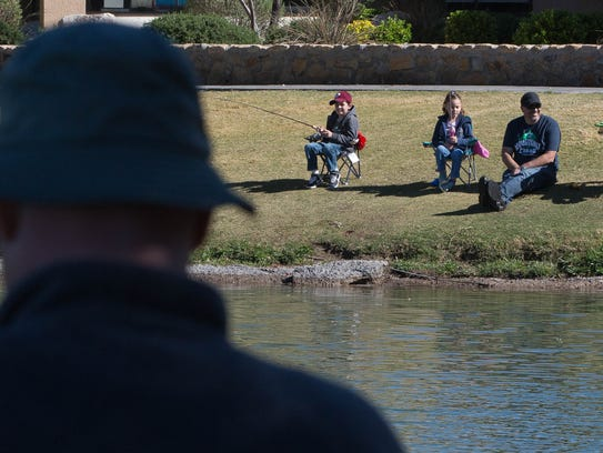 Children learn catch trout at kids fishing clinic for New mexico department of game and fish