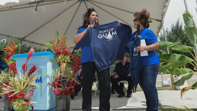 A Port Authority of Guam sweater is displayed by General Manager Joanne Brown, left, during the Port's celebration for 42 years of service at the Jose D. Leon Guerrero Commercial Port on Oct. 16, 2017.