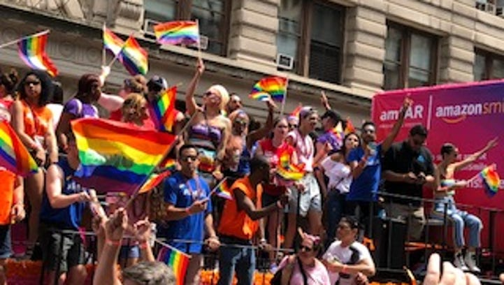 'We're here': Thousands in rainbow colors make a statement at New York City's Gay Pride parade