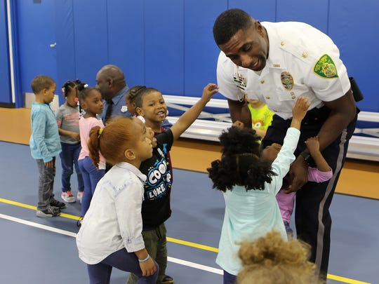 New Dover police chief Marvin C. Mailey Jr. interacts with kids at the Greater Dover Boys & Girls Club on Tuesday after addressing the launch of the Just(ice) In Time adult training program. He said he wants the youth of Dover to see who police really are and not to fear them.