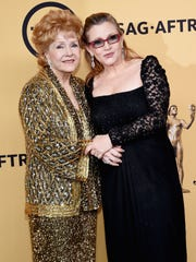 Debbie Reynolds and daughter Carrie Fisher at the 21st annual Screen Actors Guild Awards Jan. 25, 2015.
