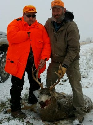Bob Schuh shows his 10-point (five-by-five western count) mule deer he shot with the help of his guide, Vince McCollam, of Wyoming Disabled Hunters. The buck had a 16-inch inside spread and was taken in the Heart Mountain region, near Cody, Wyoming.
