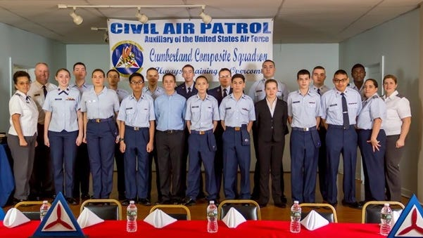 (Back row, from left) SM Scott Rodman, C/Amn Harrison Bruck, C/SSgt Victor Morales, C/CMSgt Oleh Chernenko, C/1stLt Matthew Currey, C/CMSgt Scott Rodman, C/SrA Carlos Espada II, C/SSgt Joseph Zerra, C/Capt Robert Brown; and (front row, from left) 2ndLt Cheryl Saunders-Rodman, C/SMSgt Taylor Mathis, C/ Jessica Armstrong, C/Amn Roderick Zapanta, C/ Amn Edward Rada III, C/Amn Jacob Currey, C/Amn Michael Flaville, C/Amn Sophia Born, C/A1C Kyle Coggins, C/A1C Joseph Clemenson, Capt. Jamie Currey, 2ndLt Christen Morales, members of the Cumberland Composite Squadron of the Civil Air Patrol, are pictured at the squadron's sixth annual awards banquet on Jan. 7.