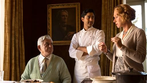 """This image released by DreamWorks II shows, from left, Om Puri, Manish Dayal and Helen Mirren in a scene from """"The Hundred-Foot Journey."""""""