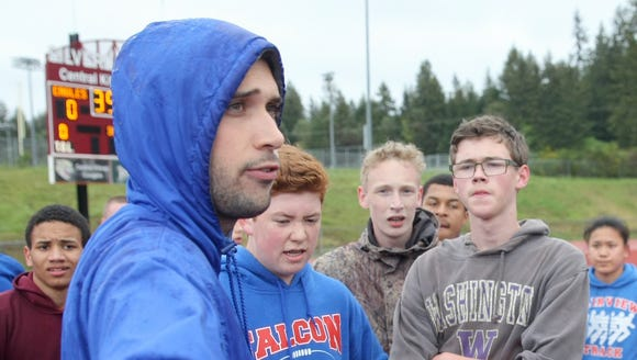 Olympic's Travis Quinn is stepped down as the Trojans' track and field/cross country coach.