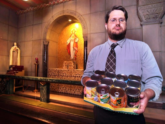 Sean Ater, director of the office of new evangelization for the Archdiocese of Cincinnati, is traveling to Philadelphia to see Pope Francis. Ater has led an effort to collect canned goods and fight hunger, one of the Pope's main goals. He is in St. Louis Church, downtown.