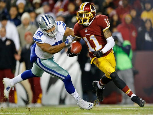 FILE - In this Dec. 7, 2015, file photo, Washington Redskins wide receiver DeSean Jackson (11) carries the ball on a kickoff return under pressure from Dallas Cowboys outside linebacker Kyle Wilber (51) during the second half of an NFL football game in Landover, Md. Jackson had his the best season with the Philadelphia Eagles playing under Chip Kelly in 2013. Yet, Kelly cut Jackson a few months after the season. There's one side of the football part of his decision. The other was his contract. (AP Photo/Patrick Semansky, File)