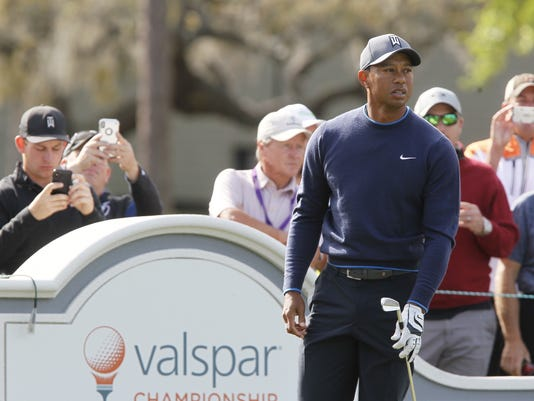 Tiger Woods watches his tee shot at Innisbrook's Copperhead course during the pro-am at the Valspar Championship golf tournament, Wednesday, March 7, 2018, in Palm Harbor, Fla (Jim Damaske/Tampa Bay Times via AP)